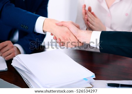 Business people shaking hands finishing up a meeting