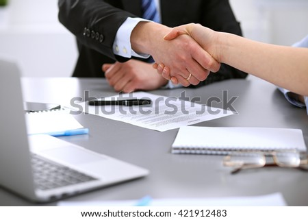 Business people shaking hands , finishing up a meeting to sign a new contract