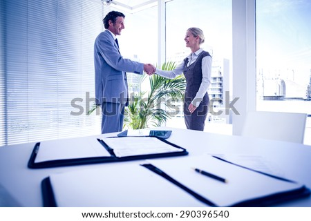 Business people shaking hands in the office - stock photo