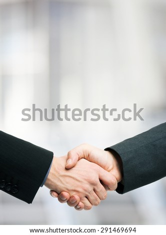 Business people shaking hands. Lots of copy-space - stock photo