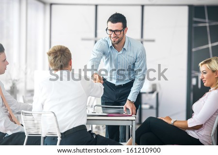 Business people shaking hands on a company meeting - stock photo