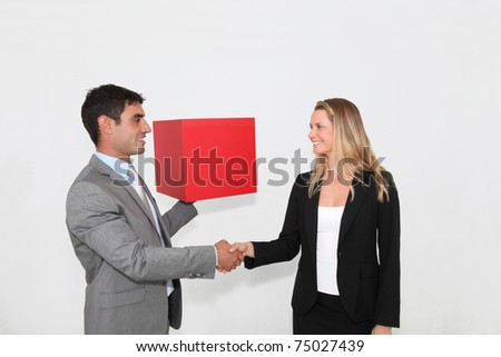 Business people shaking hands on grey background - stock photo