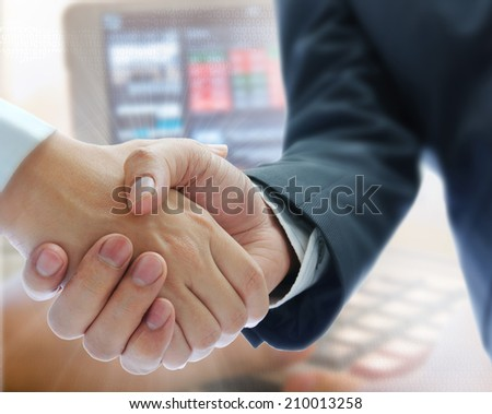 business people shaking hands on stock backgroung - stock photo