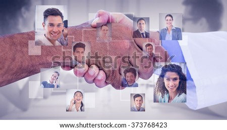 Business people shaking hands on white background against grey vignette