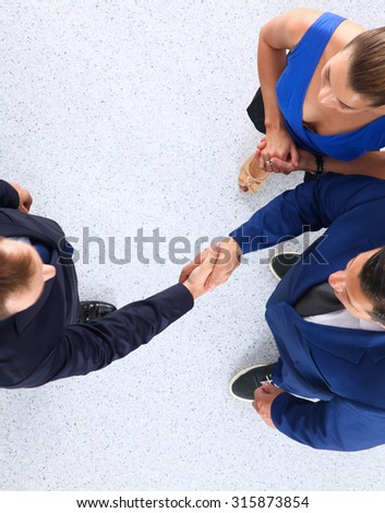 Business people shaking hands - topview