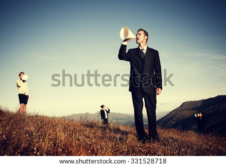 Business People Shouting Through Paper Megaphone Concept - stock photo