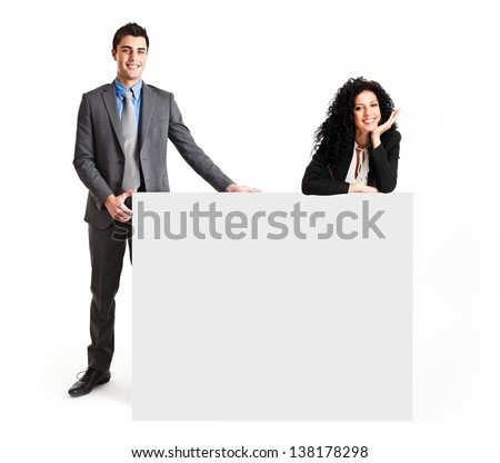 Business people showing a blank sign - stock photo