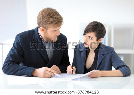 Business people signing a contract in the office