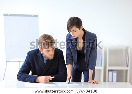 Business people signing a contract in the office - stock photo