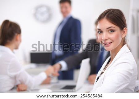 Business people sitting and discussing at business meeting. - stock photo