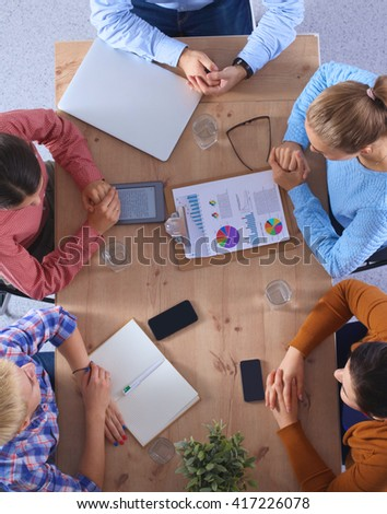 Business people sitting and discussing at business meeting, in office - stock photo