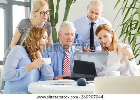 Business people sitting around the conference tablet and consulting. Teamwork at office.  - stock photo