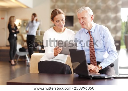 Business people sitting at seminar while working together on project. Teamwork at office.  - stock photo