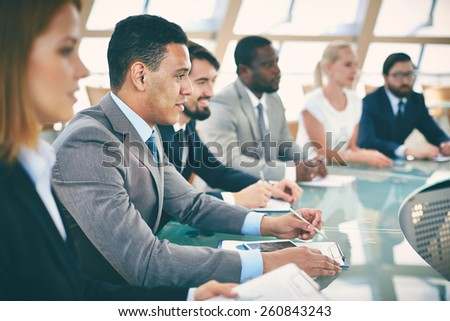 Business people sitting in conference hall