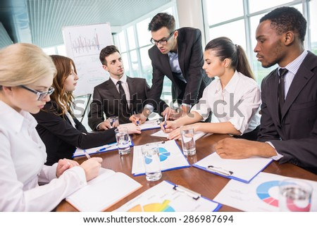 Business people sitting in conference room and working. - stock photo