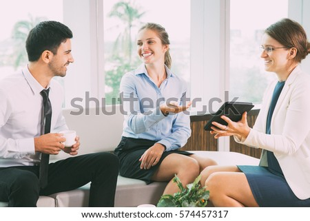 Business People Sitting in Modern Office