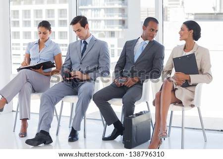 Business people sitting together in a meeting room - stock photo