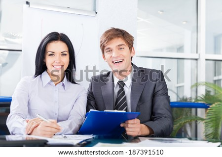 business people smile sitting at desk in office meeting, businesspeople working with colleague - stock photo