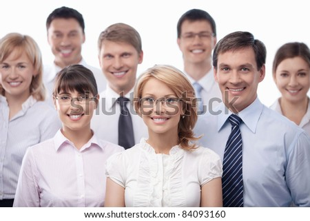 Business people smiling on white background - stock photo