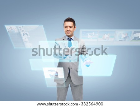 business, people, social networking, technology and mass media concept - happy smiling businessman in suit working with virtual screens - stock photo