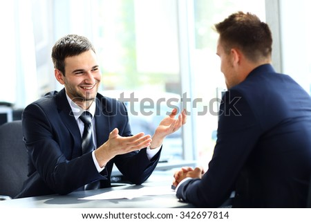 Business people speaking during interview in their office - stock photo