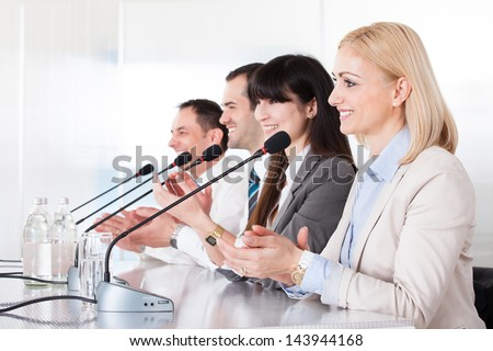 Business People Speaking In Microphone In Office - stock photo