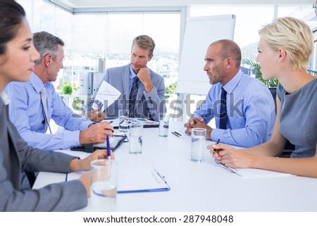 Business people speaking together during meeting in the office - stock photo