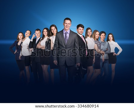 Business people stand on the blue background  - stock photo