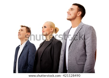 Business people standing and looking away together - stock photo