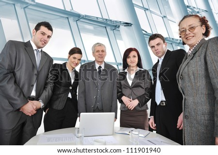 Business people standing around the table in office - stock photo