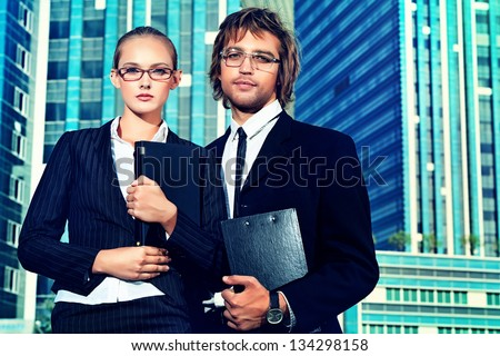 Business people standing in a big city over modern buildings. - stock photo