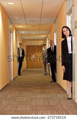 Business people standing in corridor - stock photo