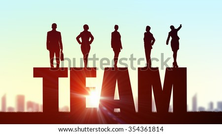 Business people standing on word team representing collaboration concept  - stock photo