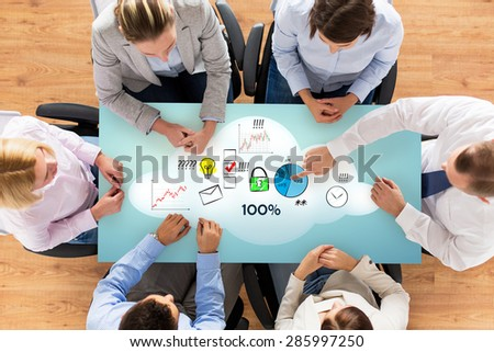 business, people, statistics, success and team work concept - close up of business group with charts and start up icons sitting at table in office - stock photo