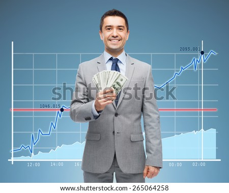 business, people, success and finances concept - smiling businessman with american dollar money over growing chart and blue background - stock photo