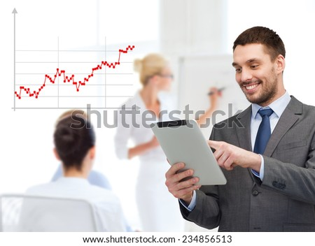 business, people, success and finances concept - smiling young businessman with tablet pc computer over gray background and forex graph going up