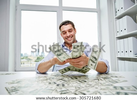 business, people, success and fortune concept - happy businessman with heap of dollar money in office - stock photo