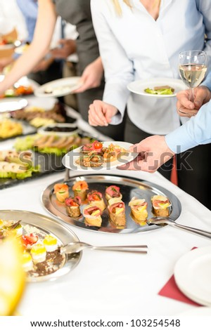 Business people take buffet appetizers at company event - stock photo