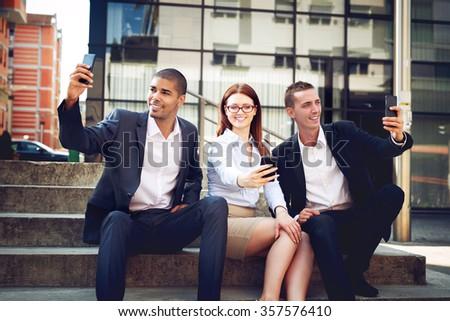 Business people taking selfies.  - stock photo