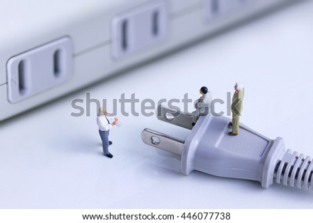 Business people talking about electric problem - stock photo