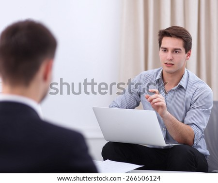 Business people talking on meeting at office, sitting - stock photo