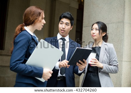 Business people talking to each other at outdoor - stock photo