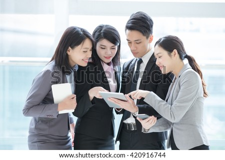 Business people team meeting with computer in the office, shot in Hong Kong, asian woman and man - stock photo