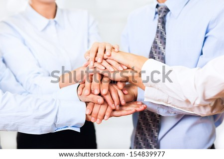 business people team putting their hands stack on top of each other, businesspeople colleagues pile of hand closeup, at office, concept of success collaboration leader