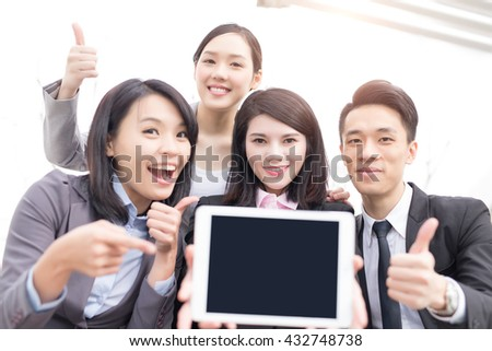 Business people team show empty computer screen with copy space, shot in Hong Kong, asian woman and man - stock photo