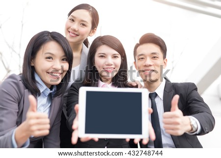 Business people team show empty computer screen with copy space, shot in Hong Kong, asian woman and man