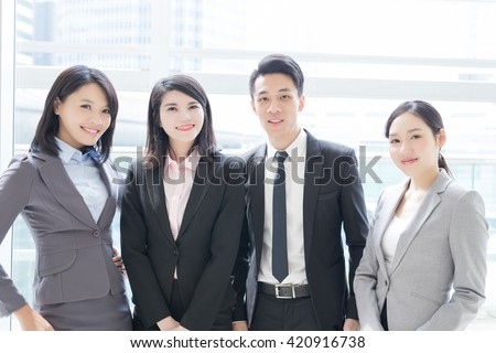 Business people team smile to you in the office, shot in Hong Kong, asian woman and man