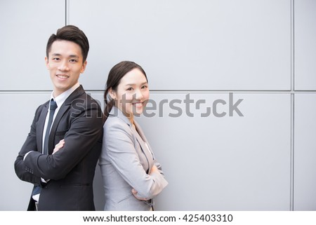 Business people team smile to you in the office, shot in Hong Kong, asian woman and man - stock photo
