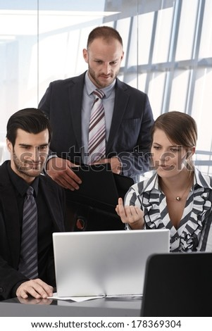 Business people teamworking at modern office. - stock photo