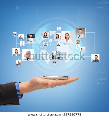 business, people, technology and communication concept - close up of male hand with smartphone over blue background with icons of contacts - stock photo